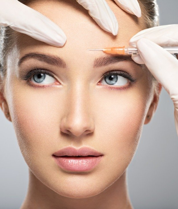 woman-getting-cosmetic-botox-injection-in-forehead-picture-id1047700026