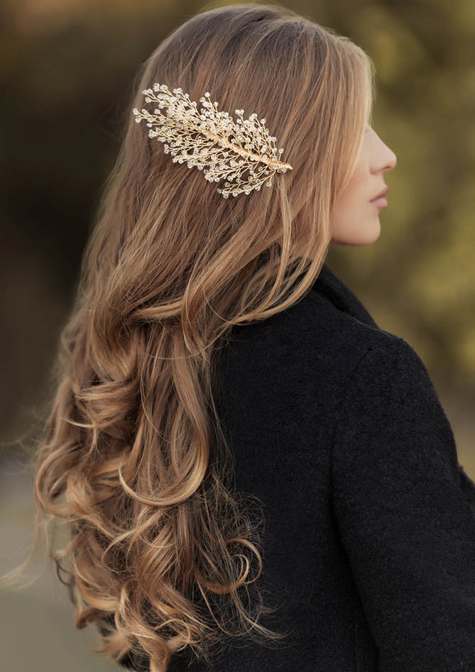 Hairstyle of long hair curly blonde with handmade gold hairpin